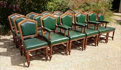 Set of 18 oak dining chairs made by Thomas Fox and Co London.jpg